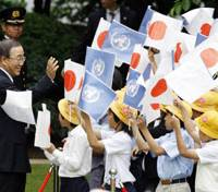 Warm welcome: U.N. Secretary General Ban Ki Moon is greeted by children during a ceremony in Tokyo on Monday. | AP PHOTO