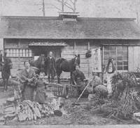 Dual roles: A family of 'tondenhei' farmer-soldiers pose in front of their house in Akkeshi, Hokkaido, in the late 1880s. | COURTESY OF HOKKAIDO UNIVERSITY LIBRARY PHOTO