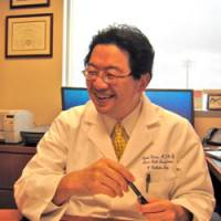 One who knows: Naoto T. Ueno, an oncologist at the University of Texas M.D. Anderson Cancer Center in Houston, speaks in his office during an interview in June. Ueno believes there is much room for improvement in doctor-patient communications in Japan. | KYODO PHOTO