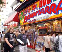 All that glitters: Tokyo's Akihabara district bustles last Thursday. The area transformed itself from the ashes of war into a mecca of electronics ? and is now a pop culture hub. | YOSHIAKI MIURA PHOTO