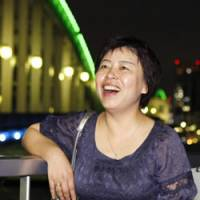 Best book: Chinese writer Yang Yi is all smiles in Tokyo on Tuesday following news that her novel 'Tokiga nijimu asa' won the coveted Akutagawa Prize. | KYODO PHOTO
