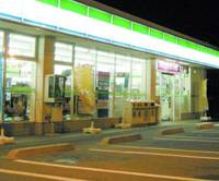 Always open: A brightly lit FamilyMart convenience store operates round-the-clock in Saitama earlier this month.   KYODO PHOTO