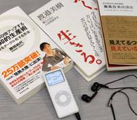Listen up: Audiobooks, recordings of books read out by narrators, can now be downloaded to portable music players such as Apple Inc.'s iPod. More and more people with busy lives are listening to books. | YOSHIAKI MIURA PHOTO