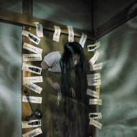 The creature walks: A ghost emerges through a door in Yurei Bukken, a haunted house at the Tokyo Dome City amusement park in Bunkyo Ward. The limited feature runs through Sept. 15. | COURTESY OF TOKYO DOME CITY PHOTO