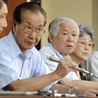 Voice of caution: Shigeo Iizuka, who represents an association of Japanese whose kin were abducted by North Korea in the 1970s and 1980s, faces reporters with other members Thursday in Tokyo. | KYODO PHOTO