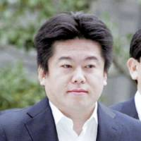 Alive and well: Livedoor Co. founder Takafumi Horie has recently resumed blogging, breaking a long silence that ensued with his 2006 arrest and subsequent conviction for insider trading and other securities law violations. | KYODO PHOTO