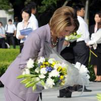 Peace offering: U.S. Speaker of the House Nancy Pelosi offers flowers Tuesday at Hiroshima Peace Memorial Park to the victims of the 1945 atomic bombing. | AP PHOTO