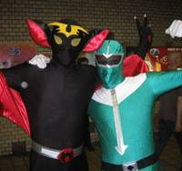 Dynamic duo: Lee Vine (right) poses as the Green Ranger from the 'Power Rangers' TV show while brother Lindsay makes like a bat at the Cosplay Parade in Nagoya on Aug 2.   MINORU MATSUTANI