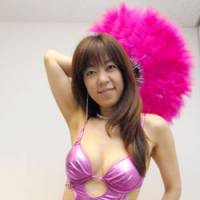 Bubble economy babe: Kumiko Araki, a frequenter of the 1990s dance club Juliana Tokyo, shows off a 'bodi-kon' outfit like those popular at the time, in an interview at the Avex Group in Minato Ward, Tokyo, on Aug. 29. | YOSHIAKI MIURA PHOTO