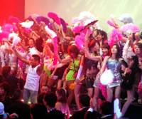The good 'old days: Women in skin-tight outfits strut on an 'otachi-dai' stage Saturday night at a hall in Tokyo's Ariake district used for a one-night revival of '90s dance club Juliana's. | YOSHIAKI MIURA PHOTO