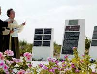 Okinawa memorial: South Korean women take part in a ceremony Sunday to unveil a cenotaph commemorating wartime sex slaves on Miyako Island, Okinawa. | KYODO PHOTO