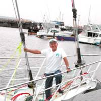 The calm before: Minoru Saito takes a break from getting the steel cutter Nicole BMW Shuten-dohji III ready for his eighth solo sailing circumnavigation. | ERIC L. DUE