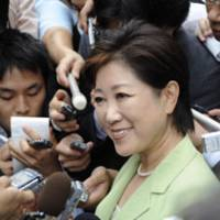 Pioneering run: Yuriko Koike, the first woman to run for president of the ruling Liberal Democratic Party, is surrounded by reporters as she campaigns in Tokyo on Friday. | AP PHOTO