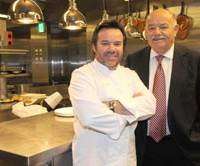 Family business: Father-and-son French chefs Michel and Pierre Troisgros pose earlier this month in the kitchen of Cuisine(s) Michel Troisgros, a restaurant Michel runs at the Hyatt Regency Tokyo. | SATOKO KAWSAKI PHOTO