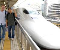 Ready to roll: Americans Corey Pedersen (left) and Mike Kim prepare to board a bullet train bound for Hakata, Fukuoka Prefecture, at Tokyo Station on Tuesday on their way to unofficially breaking the world record for greatest distance traveled by train in 24 hours. | YOSHIAKI MIURA PHOTO