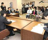 If it please the court: A mock juvenile court session is staged Tuesday at the Tokyo Family Court for the public and media. The minor and his parents sit in the front row while the judge questions them. The demonstration was acted out by court employees and a real-life judge and investigator. | SATOKO KAWASAKI PHOTO