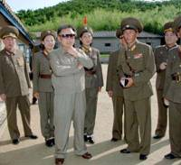 One size fits all: North Korean leader Kim Jong Il visits a military unit at an undisclosed location in this recent photo distributed by North Korean media.   KYODO PHOTO