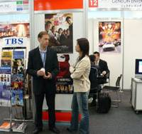 Content quest: Participants talk business in front of a booth during last year's TIFFCOM event at the Roppongi Hills complex in Tokyo.   COURTESY OF THE JAPAN INSTITUTE OF DEVELOPMENT AND PROMOTION FOR PICTURE