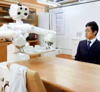 Household helper: A robot developed by Toyota Motor Corp. and the University of Tokyo clears a table Saturday during a demonstration in Tokyo. | KYODO PHOTO