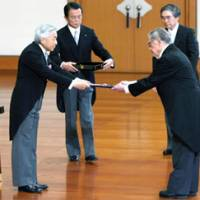 Cultured man: Japanese literature scholar Donald Keene receives the Order of Culture, the nation's top cultural award, from Emperor Akihito, with Prime Minister Taro Aso in attendance, during a Culture Day ceremony Monday at the Imperial Palace. | KYODO PHOTO