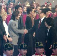 Before the fall: Music producer Tetsuya Komuro in July 1998 meets then Chinese President Jiang Zemin in Hong Kong at the first anniversary ceremony of the colony's handover to China.   KYODO PHOTO
