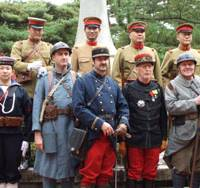 Period piece: French and Japanese in period uniforms attend a memorial ceremony commemorating the 90th anniversary of the end of World War I at the Kobe Municipal Foreign Cemetery. | ERIC JOHNSTON