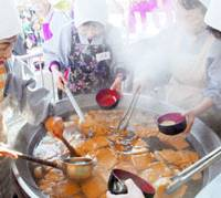 Stir it up: Meals using 'daikon' Japanese radishes are prepared Sunday during an annual Buddhist ceremony at Daihoonji Temple in Kyoto. | KYODO PHOTO