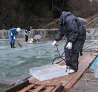 Icebreaker: Workers harvest natural ice from an ice-forming pond run by Tetsuo Asami in Nagatoro, Saitama Prefecture, in this February 2007 photo provided by Yukinari Asami. | KYODO PHOTO