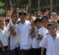 Dressed for success: Students at Alabang Elementary School in Muntinlupa, Philippines, gather outside the school wearing uniforms funded by the Japan Times Readers' Fund. | COURTESY OF PAG-ASA GROUP JAPAN