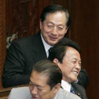 Three of a kind: Prime Minister Taro Aso shares a smile Friday with New Komeito chief Akihiro Ota (at rear) and internal affairs minister Kunio Hatoyama at the Lower House. | KYODO PHOTO