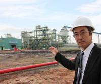 Innovative: Takuo Shigehisa, who invented 'tempura technology' to upgrade low-grade Indonesian brown coal, proudly shows a demonstration plant being built in Satui, a village in Indonesia's South Kalimantan Province. | KYODO PHOTO