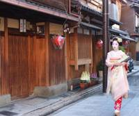Keep your distance: A colorfully dressed 'maiko' apprentice geisha walks down a Kyoto street. | COURTESY OF CITY OF KYOTO