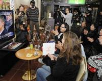 History in the making: Residents of Obama, Fukui Prefecture, including Americans, cheer early Wednesday as they watch the televised inauguration of Barack Obama as the new U.S. president. | KYODO PHOTO