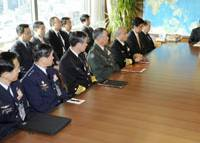 Anchors aweigh: Defense Minister Yasukazu Hamada (right) orders the Self-Defense Forces chiefs at the Defense Ministry on Wednesday to get ready to send warships off Somalia. | KYODO PHOTO