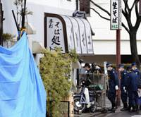 Hunting for clues: Police investigate a suspected arson at a noodle restaurant in Odawara, Kanagawa Prefecture, on Saturday.   KYODO PHOTO
