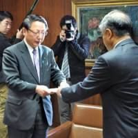 Vote of confidence: Kashiwazaki Mayor Hiroshi Aida (left) hands a notice lifting the suspension order on the Kashiwazaki-Kariwa nuclear power station in Niigata Prefecture to station chief Akio Takahashi of Tokyo Electric Power Co. on Tuesday at City Hall.   KYODO PHOTO