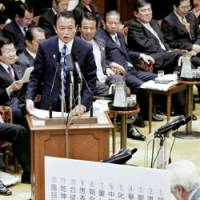 Character flaws: Prime Minister Taro Aso is quizzed on difficult kanji by an opposition lawmaker during a Diet session on Jan. 20. | KYODO PHOTO