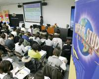 All ears: Job applicants at Universal Studios Japan listen Saturday as officials explain the part-time work being offered by the Osaka-based theme park. | KYODO PHOTO