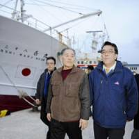 Back on home ground: Nobuhiro Funakoshi (left), a crew member of the Yoshi Maru No. 38 that was seized by Russia last month, returns to Sakaiminato port in Tottori Prefecture on Monday, accompanied by Shinsuke Iwata, president of seafood processor Hiyoshi Suisan, which owns the boat.   KYODO PHOTO