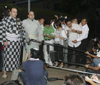 Ring of reporters: Russian sumo wrestler Roho (second from left) speaks to the media in Tokyo last September. | AP PHOTO