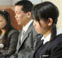 Rejected: Noriko Calderon and her Filipino parents, Arlan and Sarah, face the media Friday in Tokyo after their plea for resident status in Japan was rejected by the Justice Ministry. | KYODO PHOTO