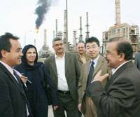 Powwow: Officials from the Japanese Embassy in Iraq and the Japan International Cooperation Agency chat Monday with officials of an oil refinery in Basra. | KYODO PHOTO