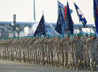 Welcome home: Air Self-Defense Force personnel in charge of the pullout work from Kuwait attend a ceremony Sunday at the ASDF Komaki base in Aichi Prefecture commemorating the formal end of Japan's reconstruction aid mission in Iraq.   KYODO PHOTO