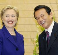 Down to business: U.S. Secretary of State Hillary Rodham Clinton and Prime Minister Taro Aso pose for a photo before their meeting at the prime minister's office Tuesday evening.   KYODO PHOTO