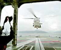 Eyes in the sky: A Maritime Self-Defense Force helicopter takes off from a destroyer during a joint antipiracy drill with the Japan Coast Guard on Friday off Hiroshima.   KYODO PHOTO