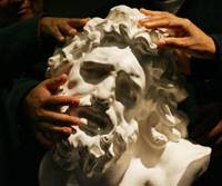 Proper reason: Blind visitors touch a replica of a statue of Laocoon and His Sons at a museum in Bogota in 2008. | AP PHOTO