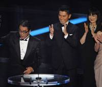 Nailing it: Director Yojiro Takita holds up an Oscar at the 81st Annual Academy Awards ceremony Sunday in Los Angeles after his 'Okuribito' ('Departures') won for best foreign-language film as actors (from left) Masahiro Motoki, Kimiko Yo and Ryoko Hirosue look on. | AP PHOTO