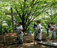 Local legend: Members of the local women's association dance at the purported grave of Jesus in Shingo, Aomori Prefecture, in June 2006. The grave is the focal point of the village's annual Christ festival. | COURTESY OF SHINGO VILLAGE OFFICE