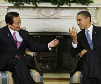 First impressions: Prime Minister Taro Aso meets with U.S. President Barack Obama in the White House Oval Office in Washington on Tuesday. | AP PHOTO
