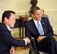 Study in contrast: Prime Minister Taro Aso meets with President Barack Obama at the White House Tuesday. | AP PHOTO